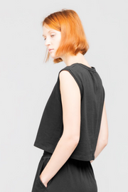 Side view of Dorsu Cropped Tank in Black, available on ZERRIN
