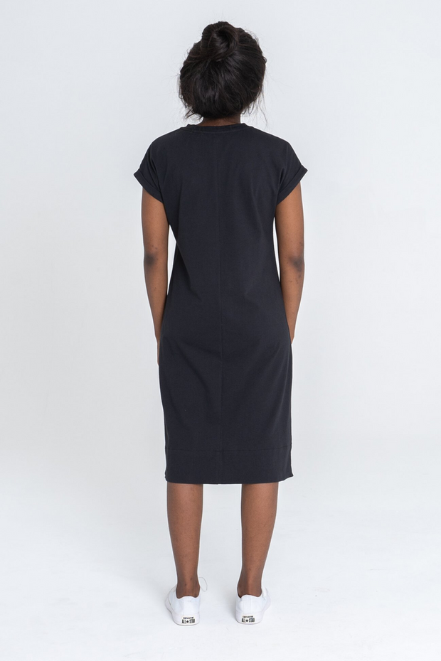 Back view of Dorsu Rolled Sleeve T-shirt Dress in Black, available on ZERRIN