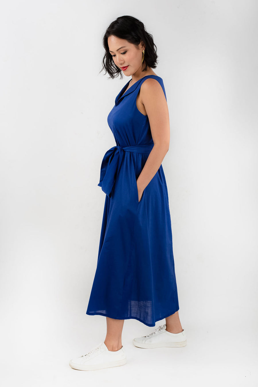 Model wears Esse blue organic cotton maxi dress, available on sustainable fashion store ZERRIN