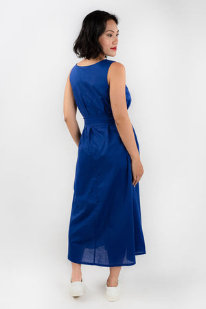 Back view of model wearing Esse blue organic cotton maxi dress, available on sustainable fashion store ZERRIN