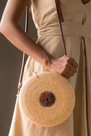 Manava handcrafted Mandala rattan roundie bag, available on ZERRIN