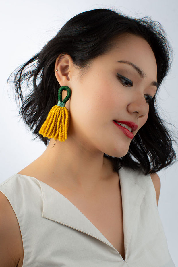 Model wears tassel Aru loop earrings by Talee from sustainable fashion store ZERRIN