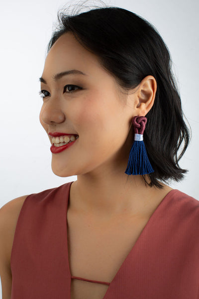 Model wears Talee tassel Hati earrings in Plum & Cobalt, available on sustainable fashion store ZERRIN