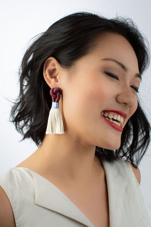 Model wears Talee Hati tassel earrings in Plum & Lily, available at sustainable fashion store ZERRIN