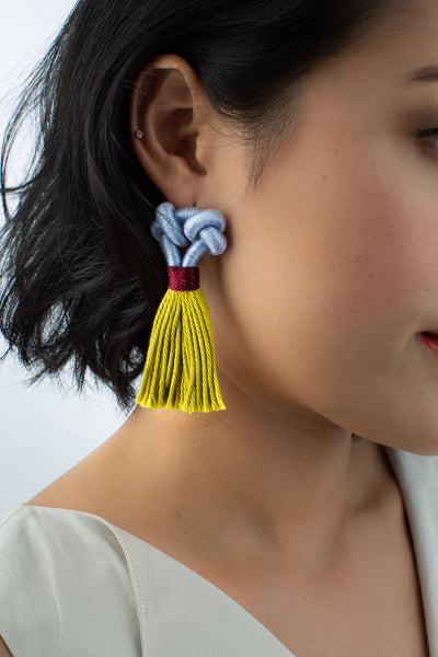Model wears Kupu tassel earrings in Tulip & Lemon colour, available on sustainable fashion store ZERRIN