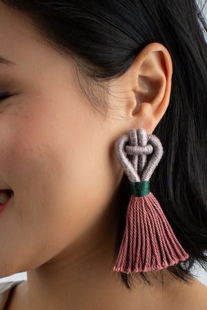 Model wears Talee tassel Angsa earrings in truffle and rosewood colour, available on sustainable fashion store ZERRIN