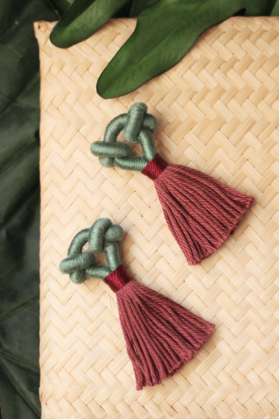 The Kupu Talee tassel earrings in Marine & Rosewood, available on ZERRIN
