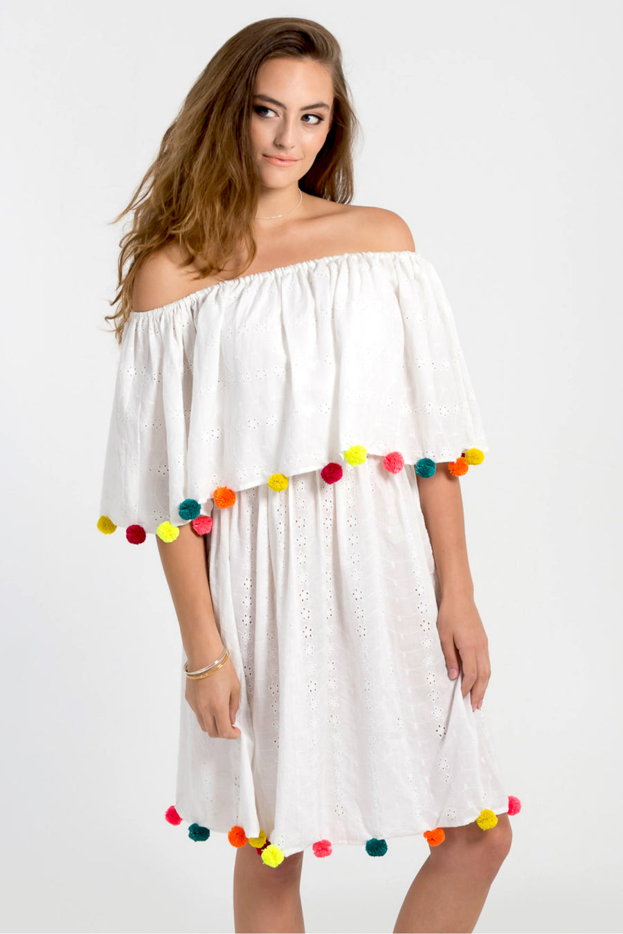 Ethically made rainbow pom pom off shoulder dress by Baliza available at ZERRIN