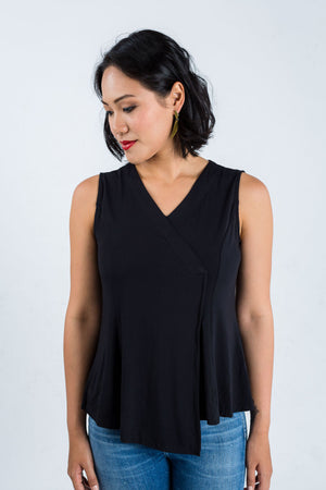 Model wears Zhai asymmetric hem dress in bamboo fibre, available on sustainable fashion store ZERRIN