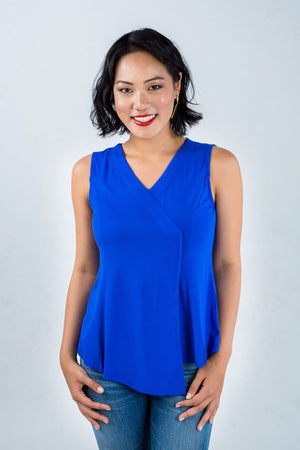 Model wears asymmetric blue top made from bamboo fibre by Zhai, available on sustainable fashion store ZERRIN