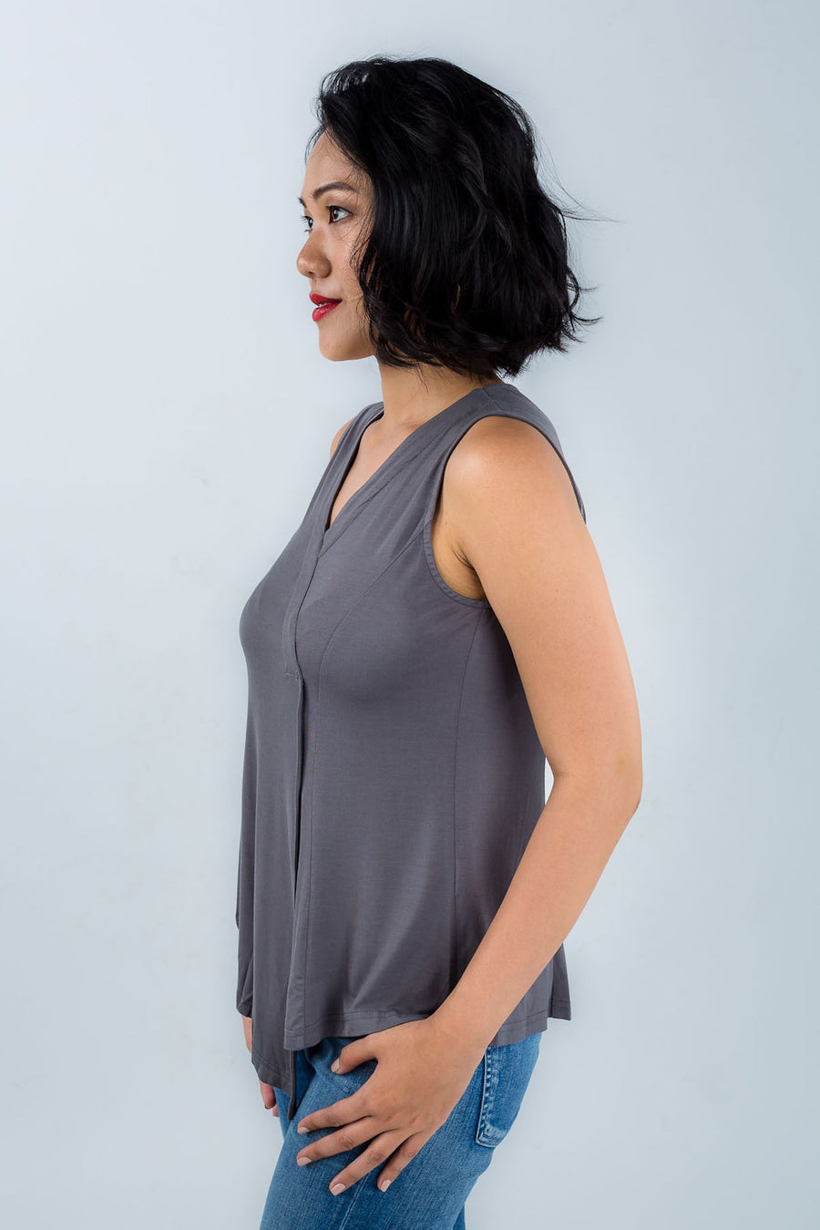 Model wears Zhai bamboo fibre asymmetric hem top in grey, available on sustainable fashion store ZERRIN
