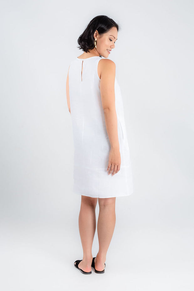 Model wears Zhai white linen a-line dress, available on sustainable fashion store ZERRIN