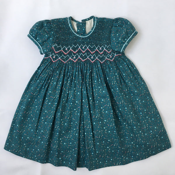 df234311c1b9 Princess Charlotte smock dress in dark green with pink and blue details