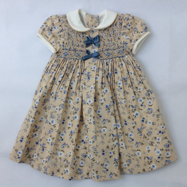 34300d2523e3 Princess Charlotte smock dress in beige with blue flowers and ribbons