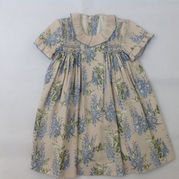 03514003a657 Princess Charlotte smock dress in beige with blue flowers