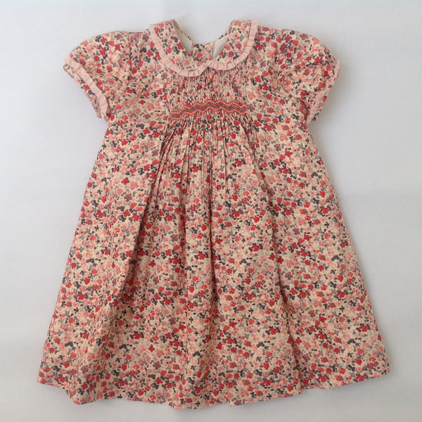5e162f27d3a2 Princess Charlotte smock dress in beige with red flowers - Traditional Spanish  baby clothes – Mibebe UK