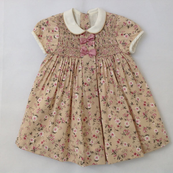 38f231c9fb47 Princess Charlotte smock dress in beige with pink flowers and ribbons -  Traditional Spanish baby clothes – Mibebe UK