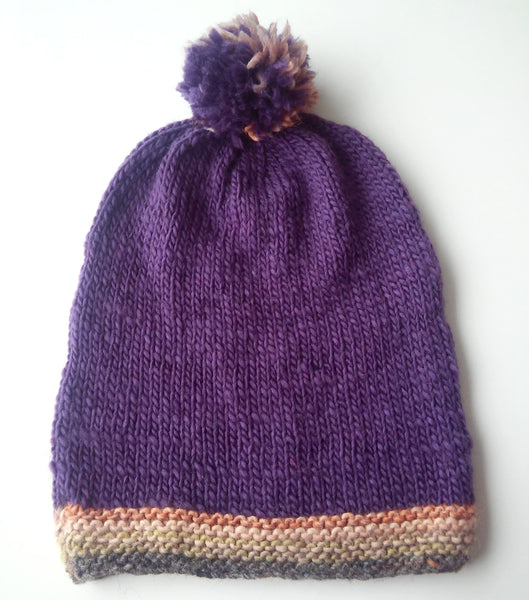 womans purple woolen slouch beanie with pompom