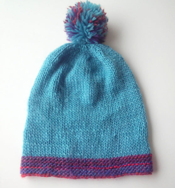 womans handknit blue beanie hat with pompom slouchy beanie