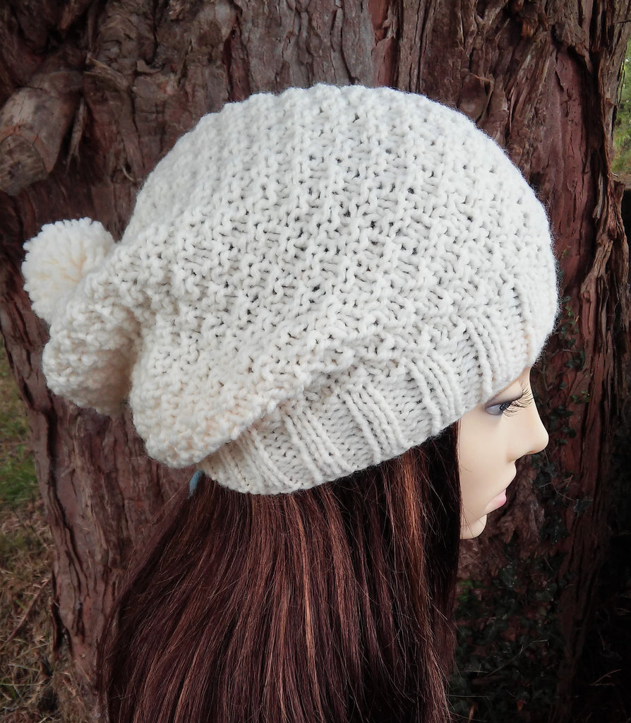 womans cream woolen pompom beanie