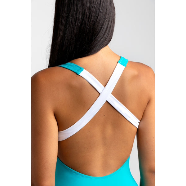 Aquamarine blue low cut one piece swimsuit. Adjustable white zipper. Crossed back design and very comfortable. Double layer fabric to avoid transparency. Bañador de espalda cruzada. Bañador con cremallera.