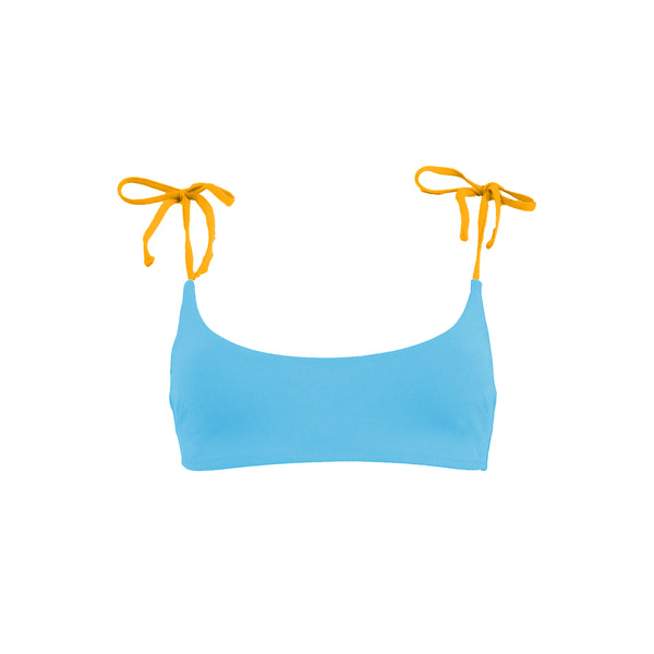 Light blue and yellow bikini top. Strappy crop top with yellow adjustable shoulder straps. Back clasp fastening. This bikini will never upset you, it will alway be one of your favorites. Top de bikini azul claro y amarillo. Crop top con tirantes amarillos ajustables. Cierre con broche en la espalda. Este bikini siempre será de tus favoritos.