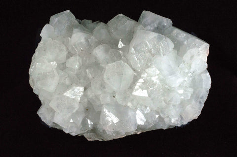White Apophyllite Cluster with natural sediment, $79, Mystical Earth Gallery