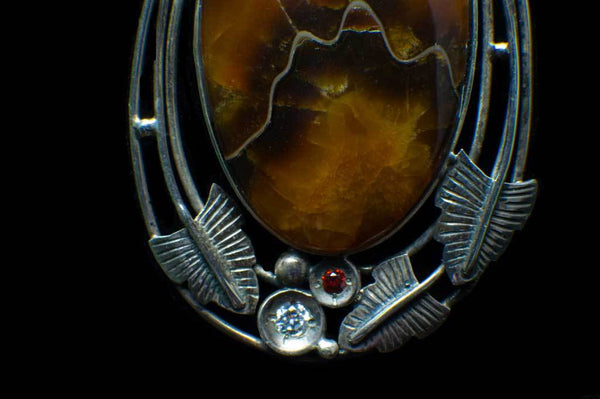 Alena Zena Simbercite Shield with Citrine & Cubic Zirconia Pendant for $199 at Mystical Earth Gallery (Close Up Silverwork View)