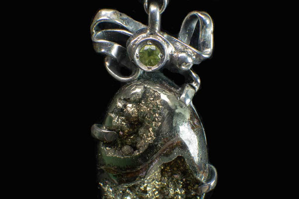 Alena Zena Pyritized Trilobite with Peridot Pendant for $219 at Mystical Earth Gallery (Close Up Peridot View)