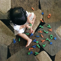 Kid Playing with Arabic numbers toys