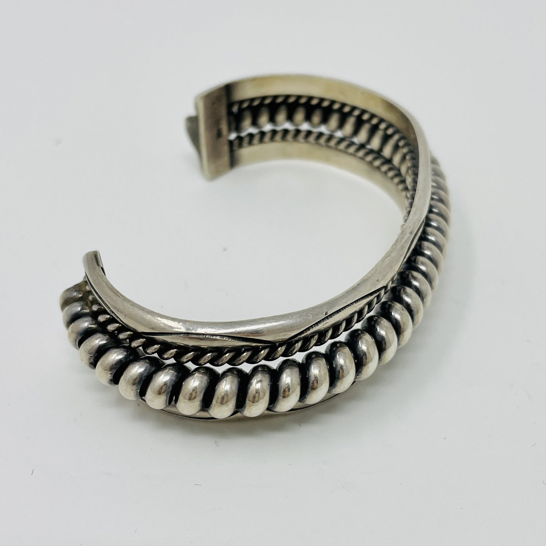 Navajo Silver Cuff with Spiral Center Surrounded by Smaller Spirals and Stampwork