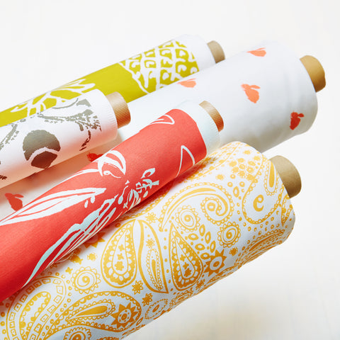 close up of fabric rolls with paintbox collection design by Nikki Szabo