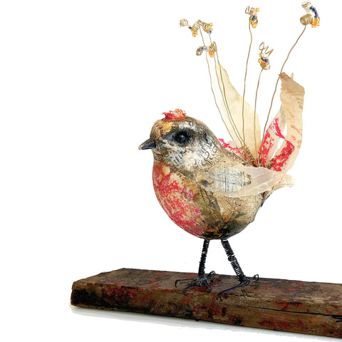 bird sculpture using paper, wire and clay