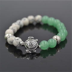 sea turtle charm 8 mm white and green bead bracelet - WikiWii