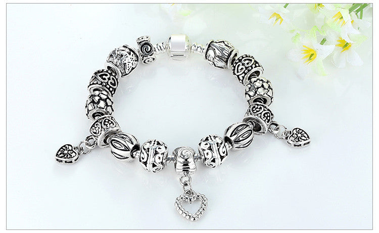 "ARTEMIS GOLD™ ""The Cold Shoulders"" Silver-Plated Charm Bracelet"