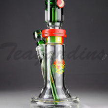 "Load image into Gallery viewer, Illadelph Glass - Limited Edition Space Monkey Straight Water Pipe - Rasta - 5mm Thickness / 17"" Height Illadelph Glass - Limited Edition Space Monkey - Double Chamber Coil Percolator Showerhead Downstem Straight Water Pipe - Rasta - 5mm Thickness / 17"" HeightIlladelph Glass - Limited Edition Space Monkey - Double Chamber Coil Percolator Showerhead Downstem Straight Water Pipe - Rasta - 5mm Thickness / 17"" Height"