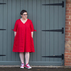 Female wearing the Emelia, A-line Dress in bright red