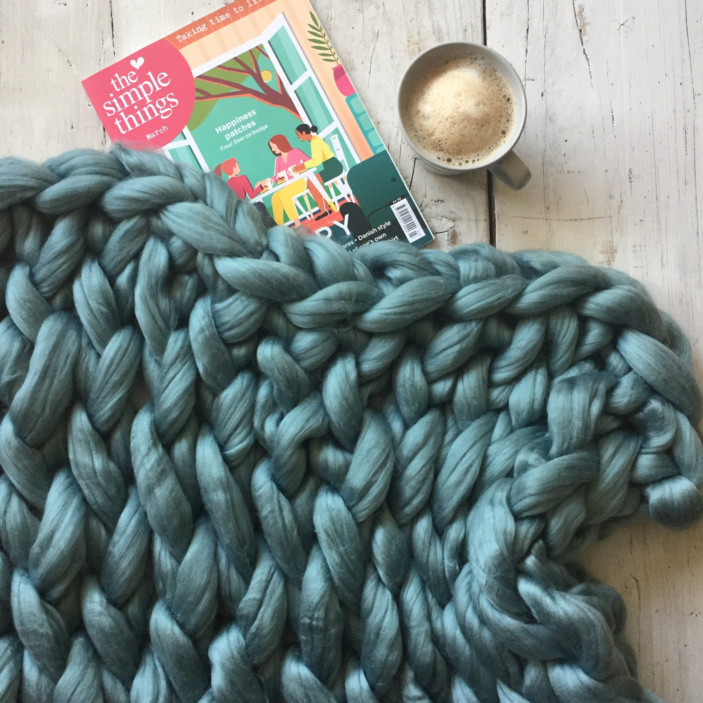 arm knitted blanket in teal wool