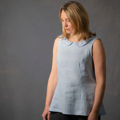 Female wearing the Iris top sleeveless sewing pattern in blue