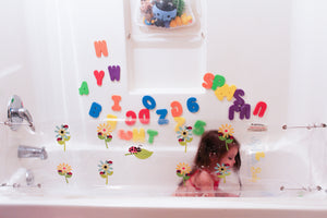 Ladybug and flowers design splash guard for bathtub playing in bathtub