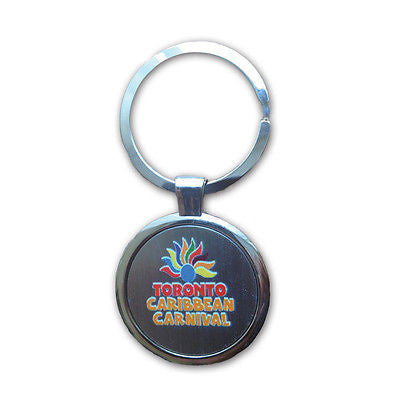 TORONTO CARIBBEAN CARNIVAL METAL KEYCHAIN , ARCH LOGO, ROUND