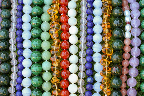A collection of therapeutic gemstone necklaces.