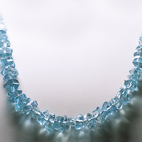 Aquamarine gemstone necklace on a display table.