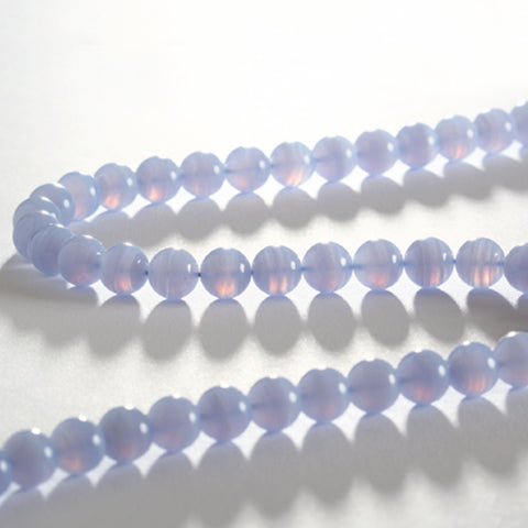 Blue lace agate gemstone necklace displayed on a white table.