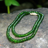 Chrome Diopside necklace on a rock in nature