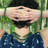 Green Jade necklaces and bracelets worn in nature