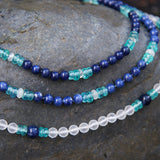 Blue apatite gemstone necklace on display table.