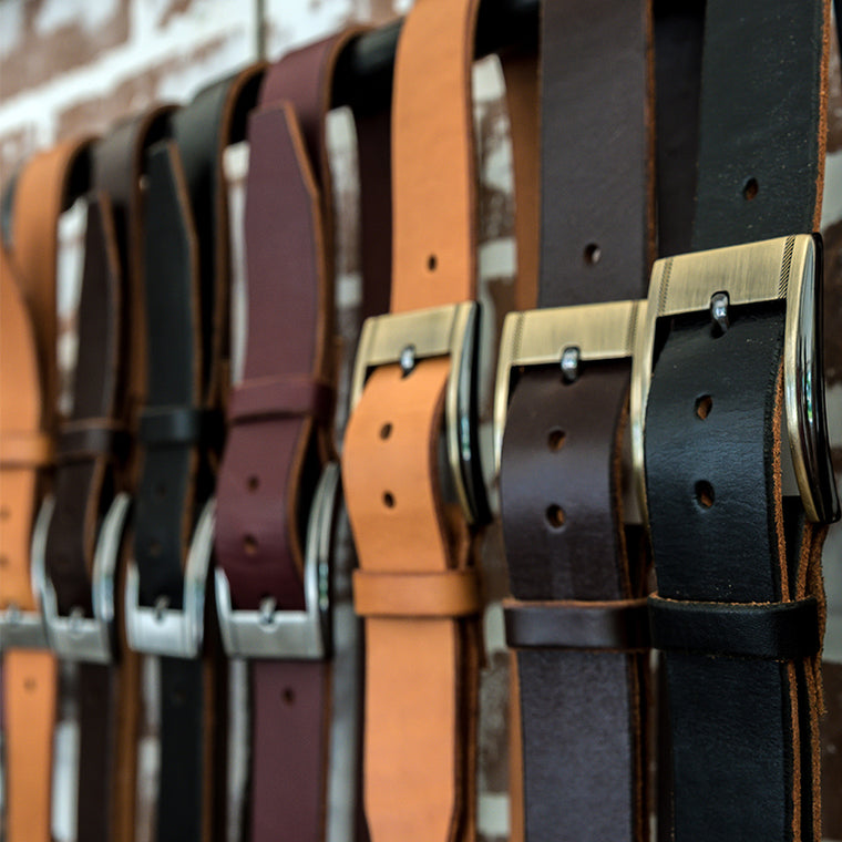 Men's leather belts - wall