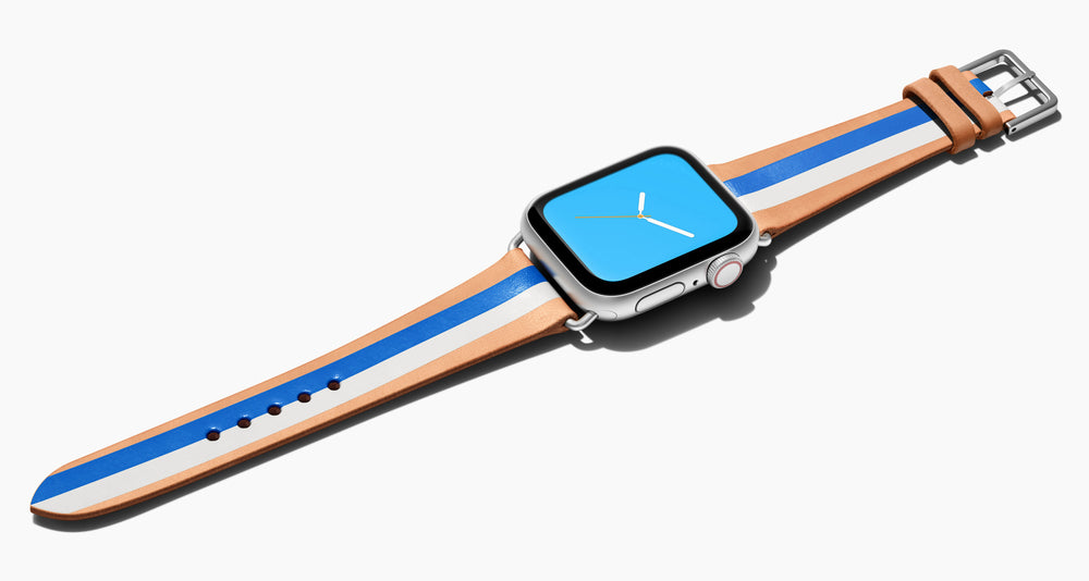 Strap for the Apple Watch handmade of natural vegetable tanned leather with two hand-painted stripes in bright blue and white in women's length which measures: 105mm and 65mm. Hardware offered in gold, black, or silver in the small and large size. Price $400 plus shipping. Please reach out with any questions.