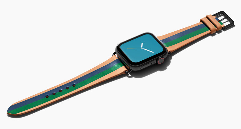 Strap for the Apple Watch handmade of natural vegetable tanned leather with two hand-painted stripes in navy blue and green in men's length which measures: 105mm and 75mm. Hardware offered in gold, black, or silver in the small and large size. Price $400 plus shipping. Please reach out with any questions.